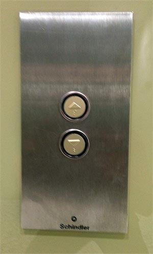 Botones ascensor hacia arriba y hacia abajo